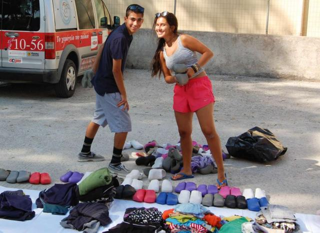 Teenage travelers perform community service at orphanage in Greece during summer youth volunteer program