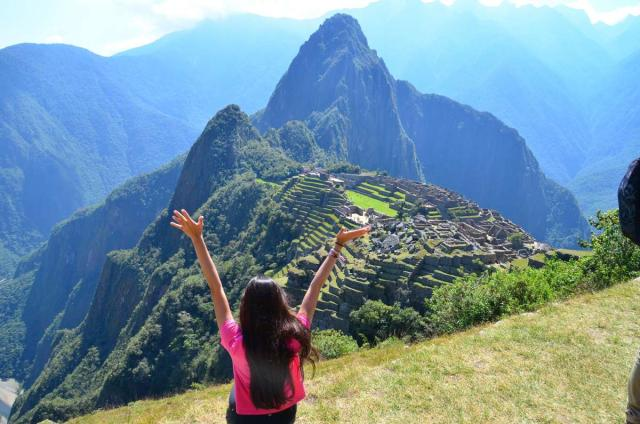 A happy teen at Machu Picchu on her summer adventure tour of Peru.
