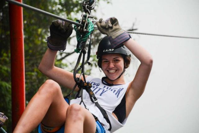 A teen zip-lines through the canopy on her summer adventure tour of Costa Rica.