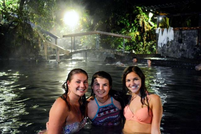 Teen friends enjoy the water on their Costa Rica adventure tour.