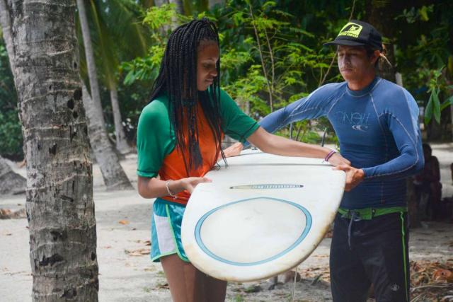 A student learns how to surf on her adventure tour in Costa Rica.