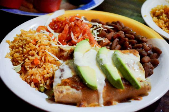Students capture a photo of traditional cuisine on their Costa Rica teen tour.
