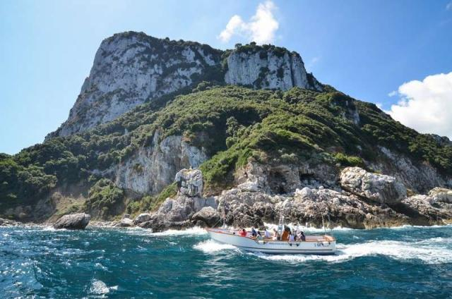 Beautiful island scenery in the Mediterranean Sea seen by teenage travelers during summer youth travel program in Greece