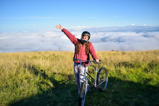 Teens go mountain biking in Hawaii on summer service program.