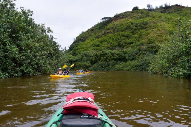 Students go kayaking in Hawaii on summer adventure travel program.
