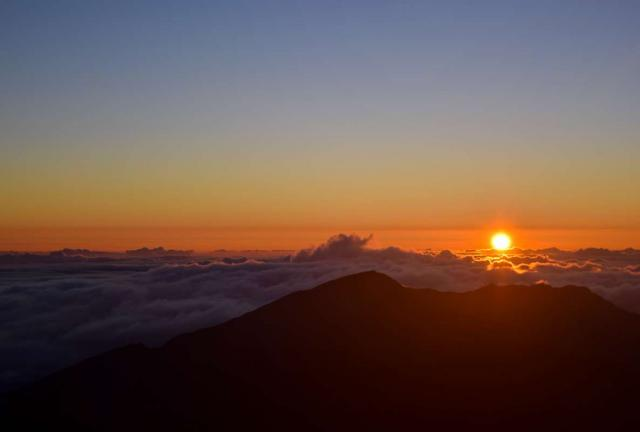 Teens enjoy sunset over a mountain in Hawaii on summer youth travel program.