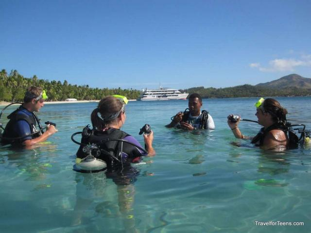 Teenage travelers learn how to scuba dive during summer youth program in Fiji