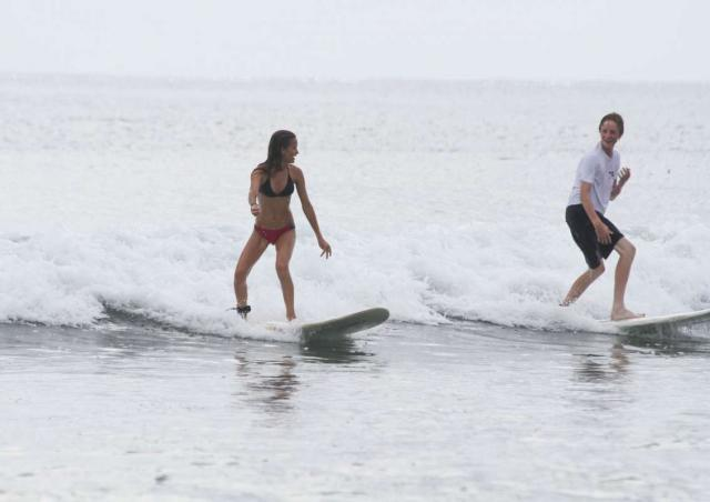 Teens learn how to surf on summer travel program in Costa Rica.
