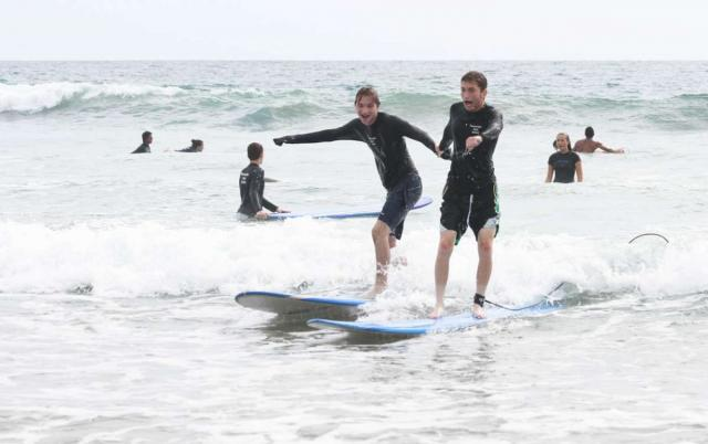 Teen boys learn how to surf on summer travel program in Costa Rica.