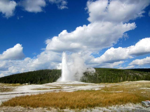 Old Faithful in Yellowstone on a summer teen tour across the USA