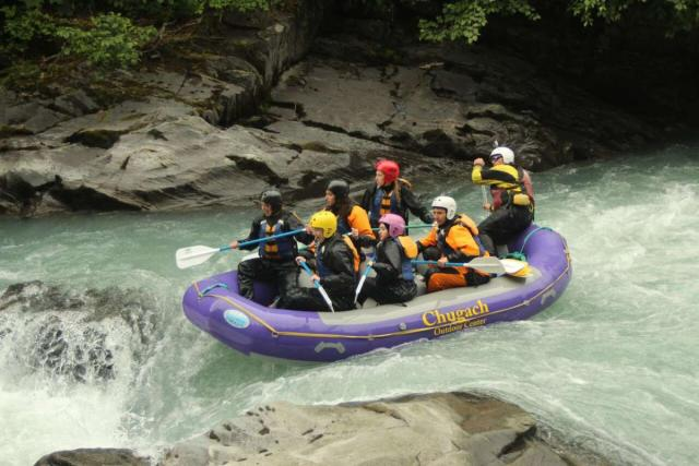 Teens go river rafting on their summer travel tour of Hawaii and Alaska.