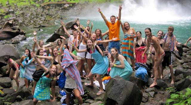 Happy group of teens enjoy the outdoors on summer service and adventure tour in Costa Rica.