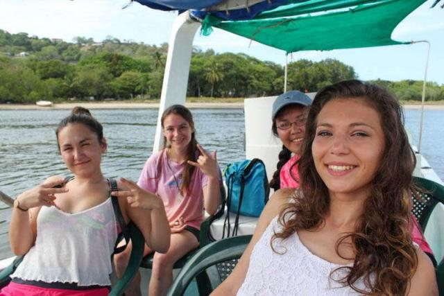 Teens enjoy a boat ride in Costa Rica on adventure travel tour.