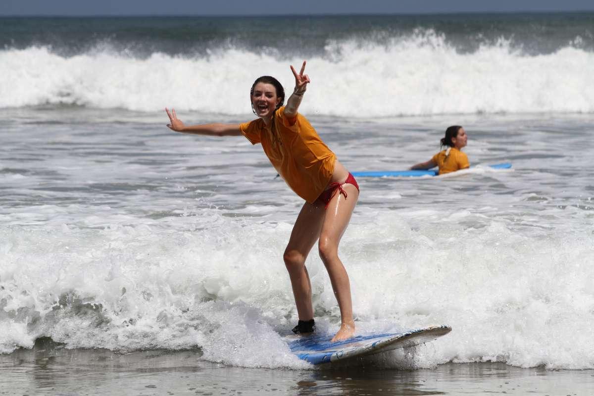 Teen enjoys surfing in Costa Rica on summer student travel program.