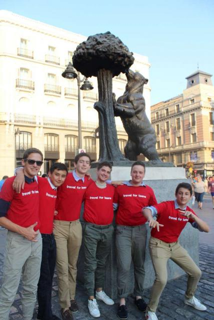 Teenage travelers in Madrid Puerta del Sol during summer Spanish language immersion program