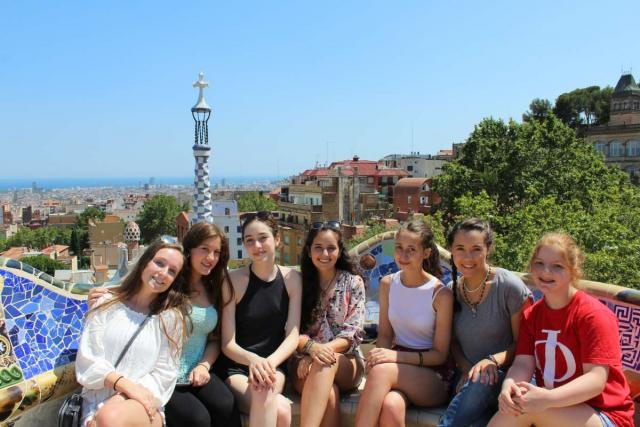 Teenage travelers in Park Guell Barcelona during summer Spanish language immersion program