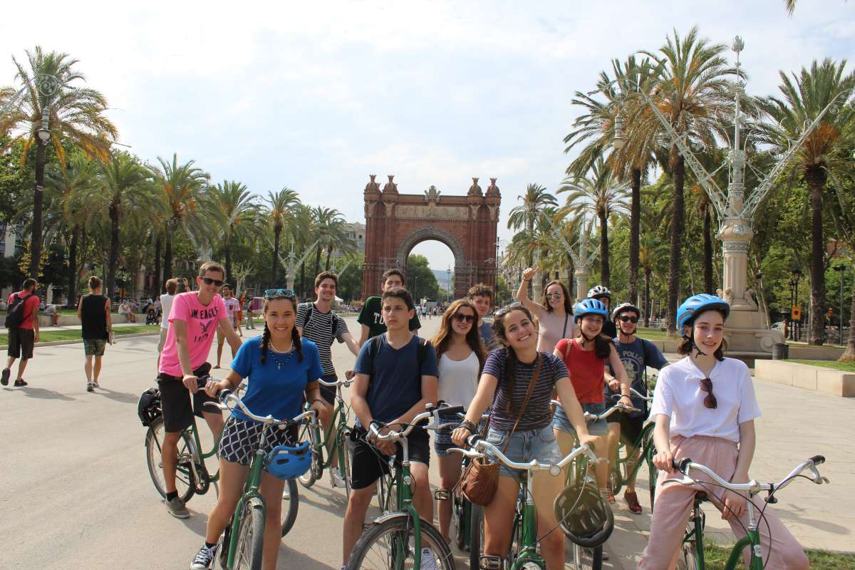 Teen travelers bike through Barcelona on youth travel program in Spain