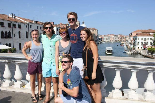 Teens pose for a photo in Italy while on their summer program.