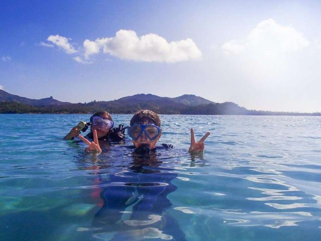 High school travelers dive into the ocean on their summer teen tour to the Land Down Under.
