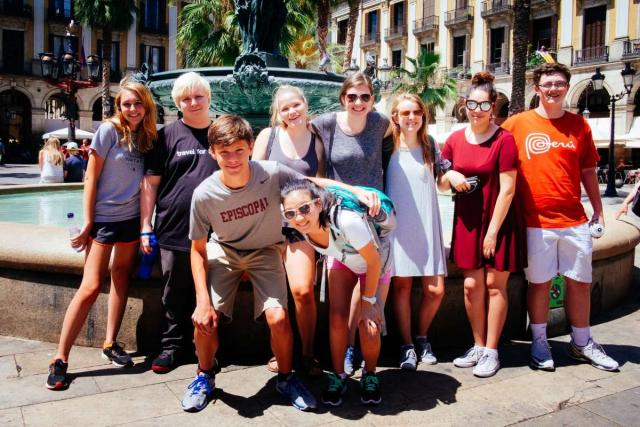 Teenage travelers in Barcelona Plaza Real during summer youth travel program