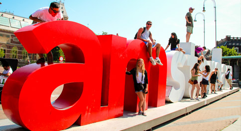 Teen travelers having fun in Amsterdam on summer youth program