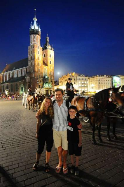 Teens in Krakow Main Square at twilight on summer youth travel program