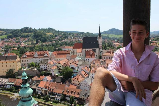 Teen relaxes in Cesky Krumlov during summer youth travel program