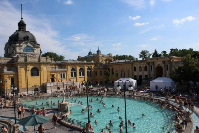 Teens relax in Szechenyi Baths Budapest during summer youth travel program