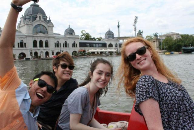 Teens on boat cruise of Danube River during summer youth travel program