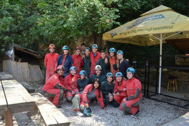 Teens caving in Budapest during summer youth travel program