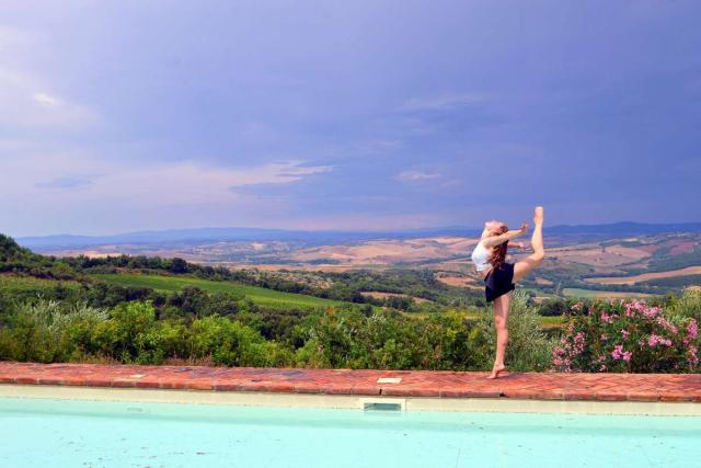 Student strikes a pose at a vineyard in Tuscany on teen travel program in Italy.