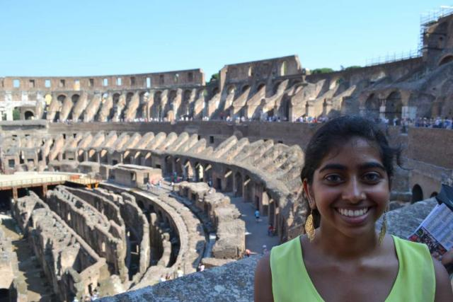 Students explore the Colosseum on their teen tour of Rome, Italy.