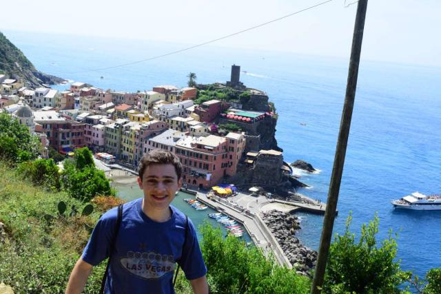 High school boy hikes the Cinque Terre on their summer teen tour to Italy.