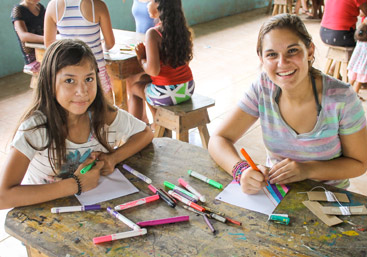 Teen spends time with local girls on community service summer program in Costa Rica.