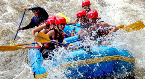 Group of students goes white water rafting in Costa Rica on summer teen adventure program.