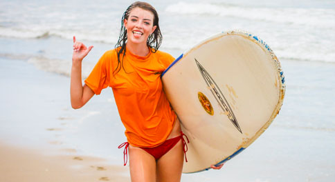Teen enjoys surfing on her summer travel and adventure tour in Costa Rica.