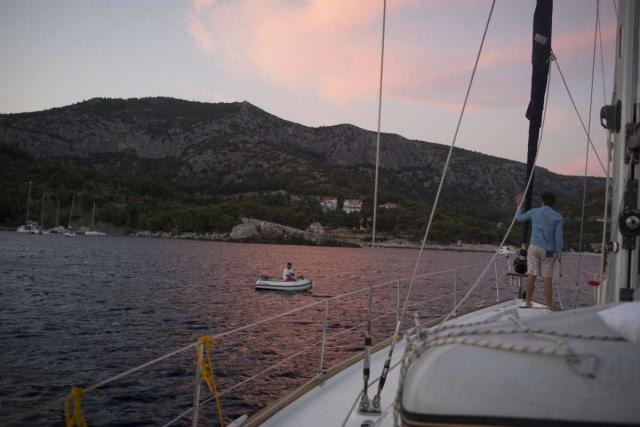 Teen traveler sails through Croatia islands in Adriatic Sea on summer adventure program
