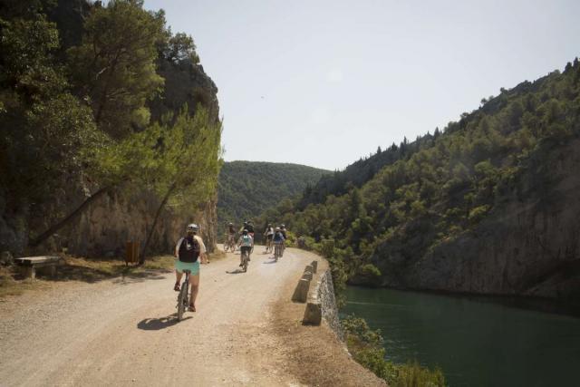 Teenage travelers bike through Croatia on summer adventure travel program