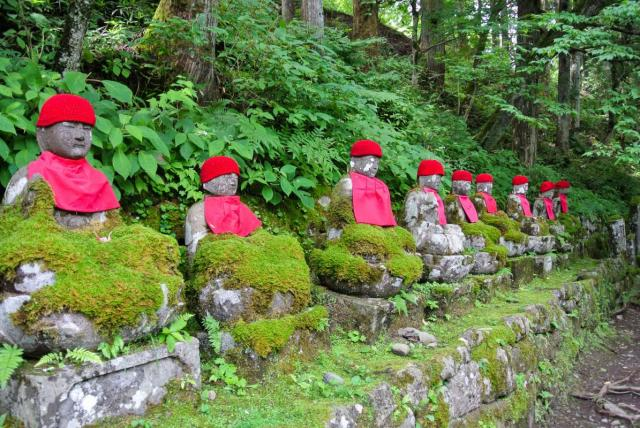 Religious statues seen by teenage travelers during summer youth travel program in Japan