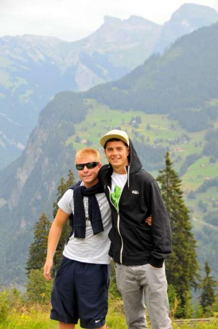 Teenage travelers hiking in Swiss Alps during summer teen adventure travel program