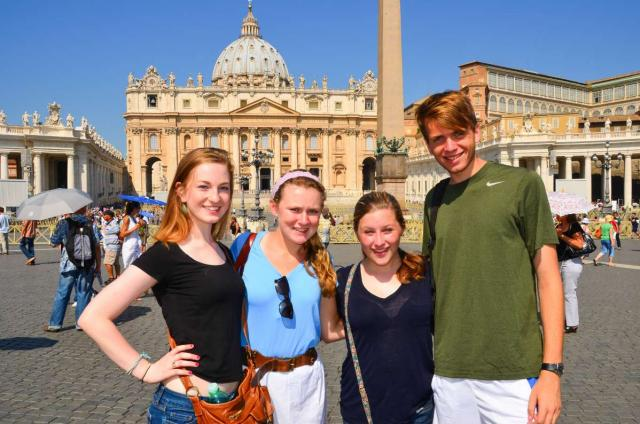 Teen travelers at Saint Peter's Basilica Vatican City during summer youth travel program in Rome