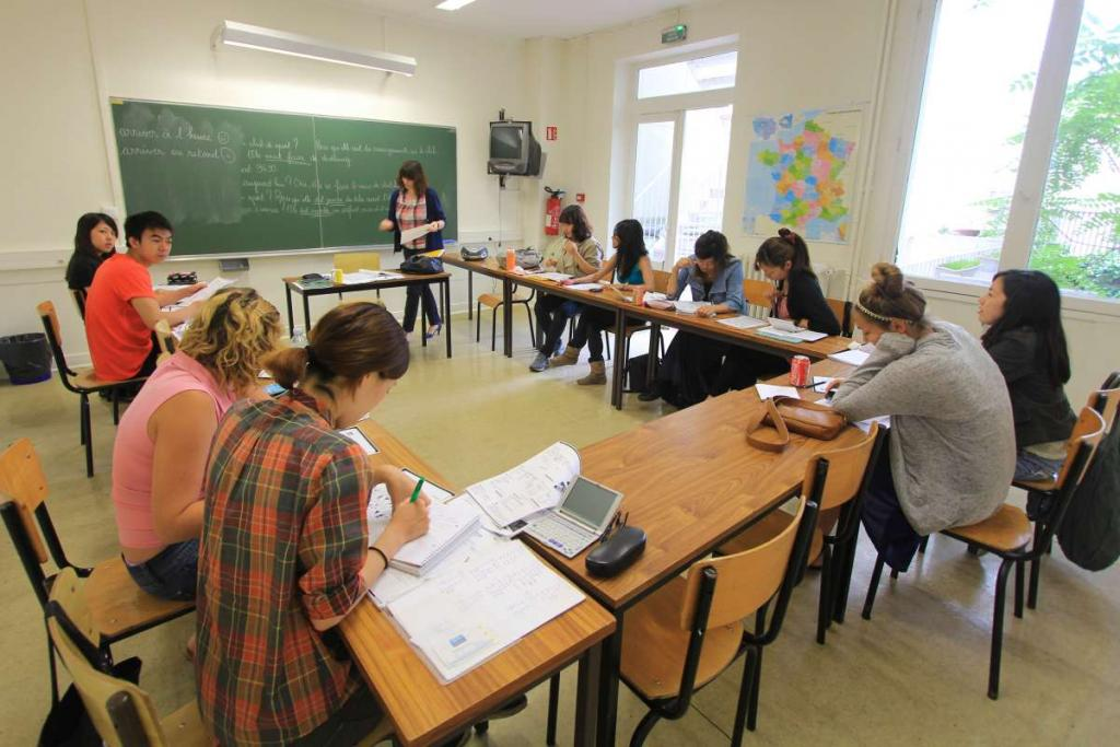 Teenage travelers learning French at Paris academy during summer language immersion program