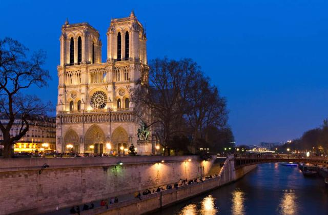 Notre Dame Cathedral of Paris at twilight seen on summer teen travel program