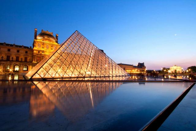 Louvre Museum at twilight as seen on summer teen travel program in Paris