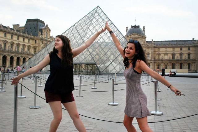 Teen travelers tour Louvre Museum on summer youth program in France