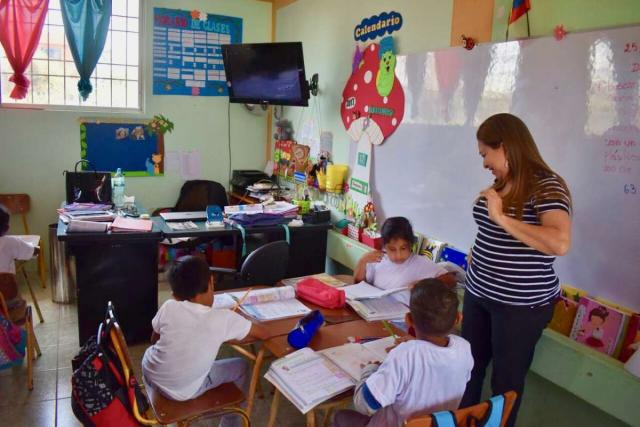 Students work with school children on their teen service program in Ecuador and the Galápagos Islands.