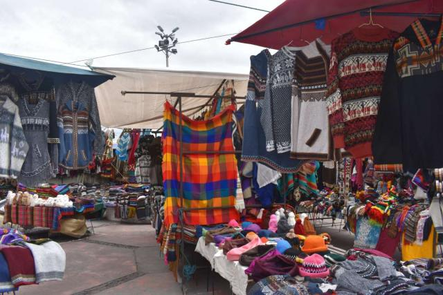Teens capture a scene from a market on their travel tour of Ecuador and the Galápagos Islands.