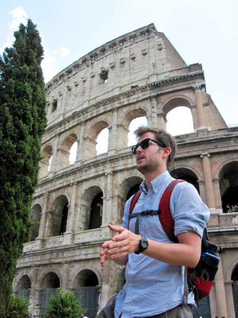 Travel For Teens counselor teaches students about Rome and Colosseum during summer teen travel program