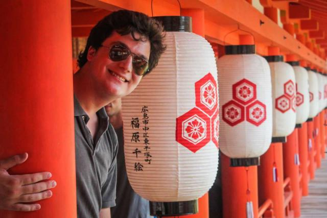 Teenage traveler with Japanese paper lamps during summer youth travel program in Japan