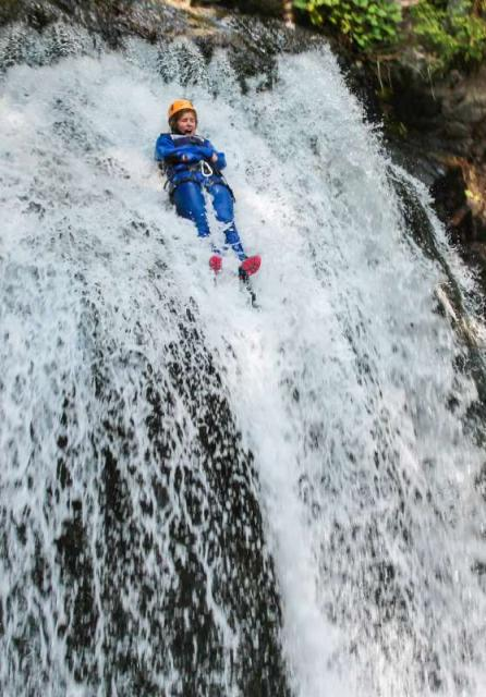 Teen does canyoning adventure on Europe summer travel tour